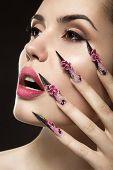 stock photo of long nails  - Beautiful girl with long nails and sensual lips - JPG