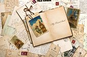 image of handwriting  - old postcards letters mails and open journal with sample text My Travel Book - JPG
