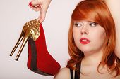 image of stilettos  - Fashion girl with red high heel shoes stiletto boots with gold studs - JPG