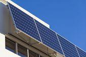 stock photo of track home  - Adjustable solar panel installation on modern home - JPG