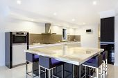 pic of penthouse  - Luxurious new kitchen with LED lights and modern appliances - JPG
