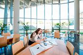 stock photo of canteen  - Girl studying in the University canteen - JPG