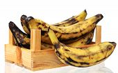 stock photo of plantain  - over ripe plantain banana in crate isolated on white background - JPG