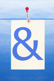 foto of ampersand  - Seamless washing line with paper against a blue sky showing ampersand - JPG