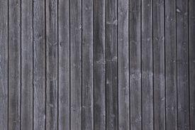 stock photo of prank  - black wooden pranks in vertical composition - JPG