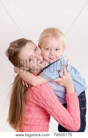 Mom And Three Year Old Son Strongly Embrace Each Other
