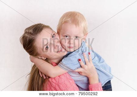Young Girl Hugging Her Son