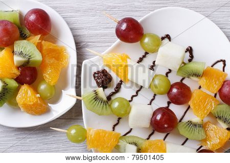 Grapes, Kiwi And Orange On Skewers Horizontal  Top View