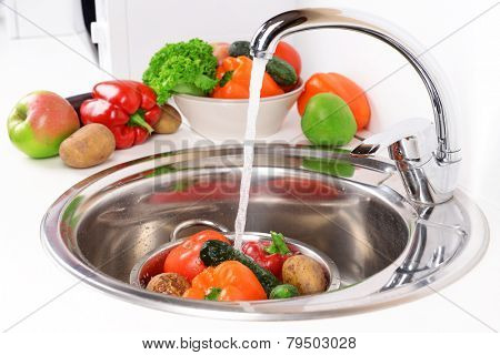 Washing fruits and vegetables close-up
