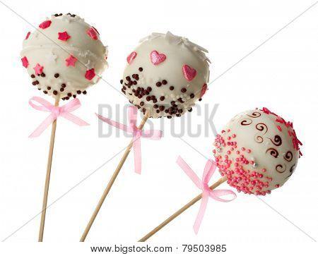 Tasty cake pops, isolated on white