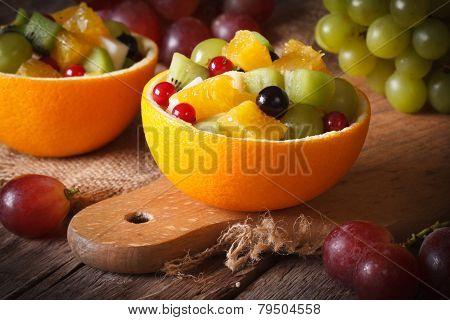 Oranges Stuffed With Fresh Fruit Salad Close-up Horizontal