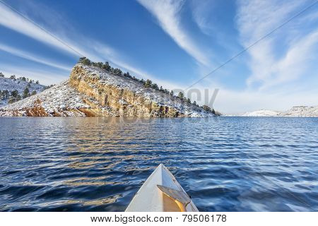 canoe paddling on Horsetooth Reservoir near Fort Collins in northern Colorado, winter scenery