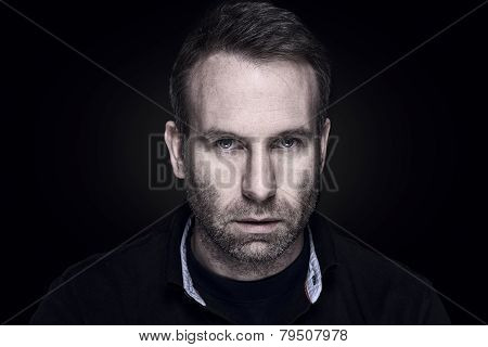 Handsome Unshaven Man With A Sombre Expression