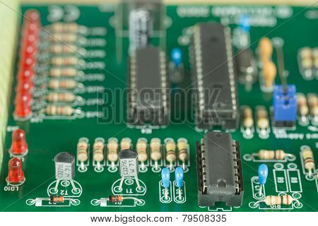 A green printed circuit board with electronic components