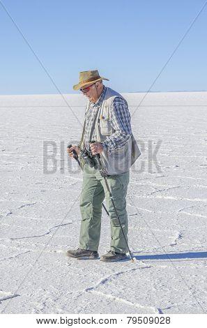 Senior man visiting Salar de Uyuni, Bolivia