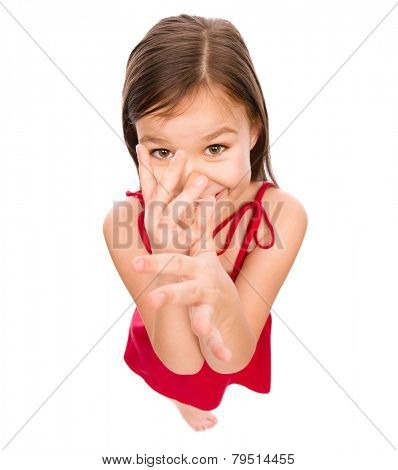 Little girl in red dress showing big nose, mocking, fisheye portrait, isolated over white