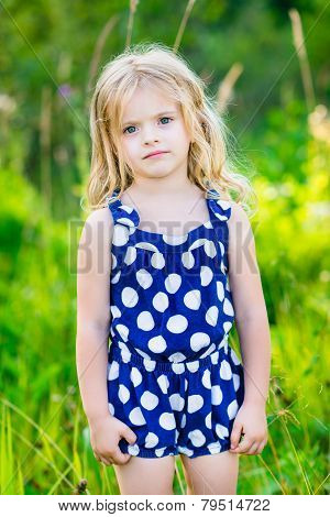 Cute Little Girl With Long Blond Curly Hair, Outdoor Full Length Portrait In Summer Park