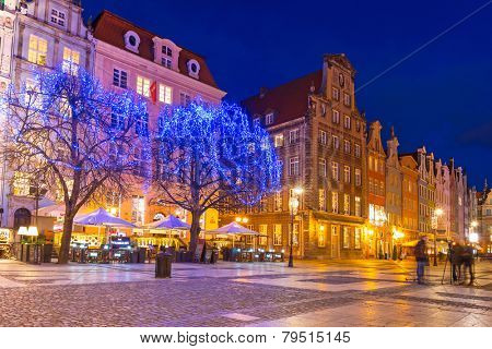 GDANSK, POLAND - DECEMBER 17, 2014: Christmas tree and decorations in old town of Gdansk, Poland. Baroque architecture of the Long Lane is one of the most notable tourist attractions of the city.