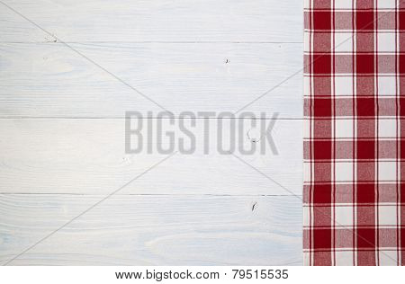 red folded tablecloth over old wooden table