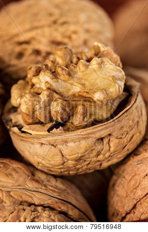 Whole Walnuts And Walnut Kernel In A Wicker Basket Close-up