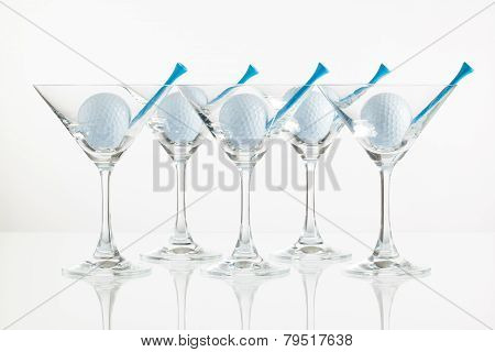 Five Glasses Of Champagne And Golf Equipments