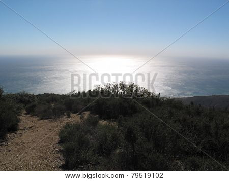 looking out on hill top at the pacific ocean