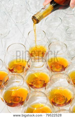 pouring the brandy or cognac
