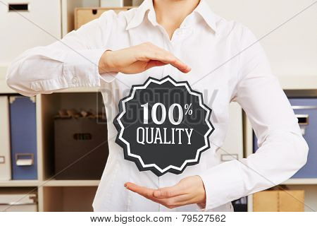 Business woman in office guaranteeing 100% quality with a hovering badge