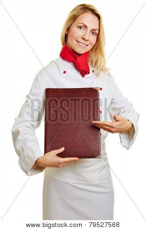 Female smiling cook giving food recommendation with menu in her hand