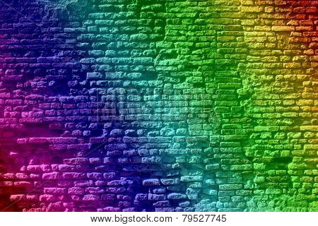 Concept or conceptual colorful painted or graffiti old vintage grungy brick wall texture or urban background