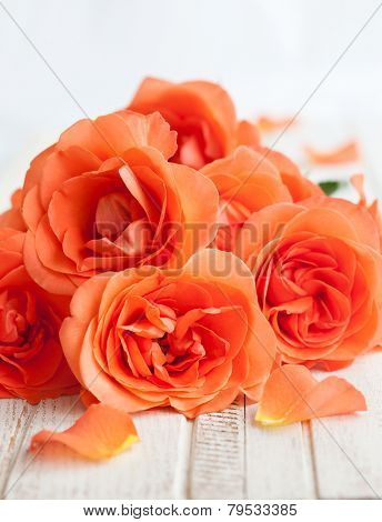 bouquet of roses on the vintage wooden background
