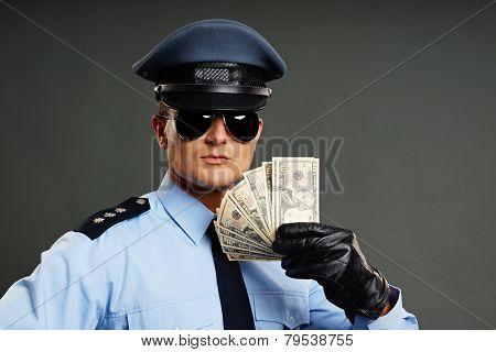 Policeman shows money