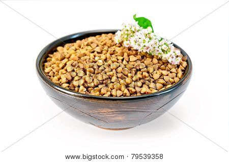 Buckwheat in brown bowl and flower