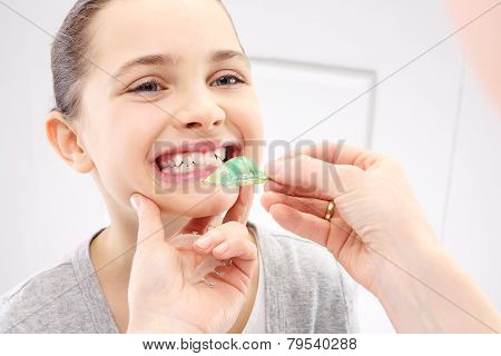 Portrait of a little girl with orthodontic appliance