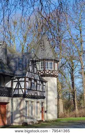 Dusseldorf, Germany - view of old houses in park by castle eller