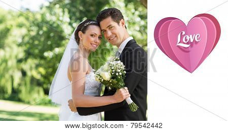 Love heart against loving newly wed couple in garden