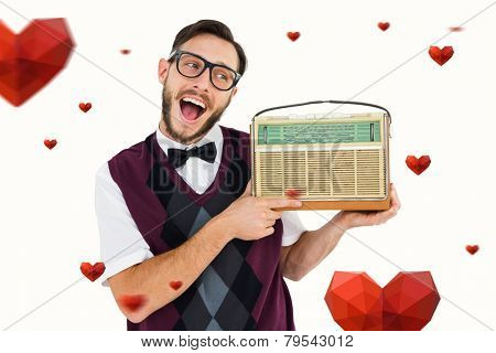 Geeky hipster holding a retro radio against hearts