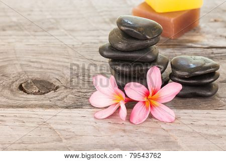 Plumeria Flowers, Soaps And Black Stones Close-up