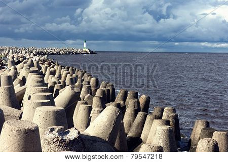 Breakwater With Concrete Fortifications And A Beacon