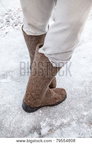Male Feet With Traditional Russian Felt Boots