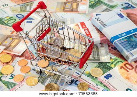 Shopping Cart Standing On Euro Banknotes