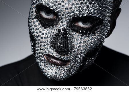 Serious Woman With Rhinestone Skull