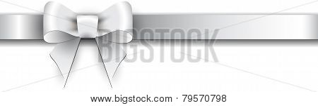 Silver Bow On A White Background