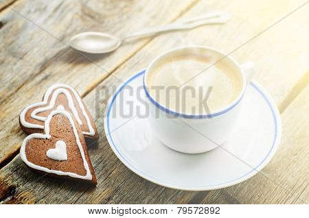 Cup Of Coffee With The Chocolate Cookies In The Shape Of A Heart