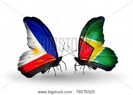 Two Butterflies With Flags On Wings As Symbol Of Relations Philippines And Guyana