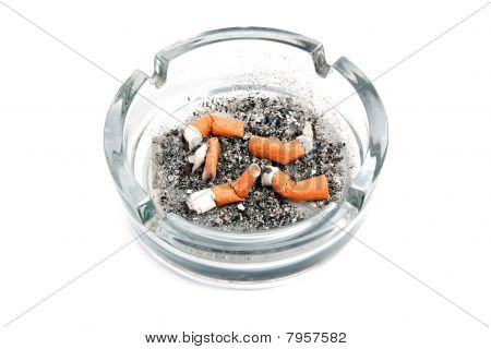 Glass Ashtray With 5 Cigarette Buds Isolated On White Background
