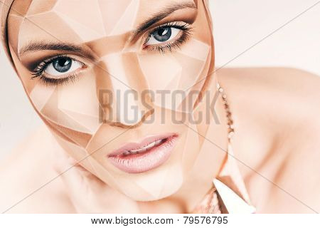 Beautiful Woman With Geometrical Bodyart On Face