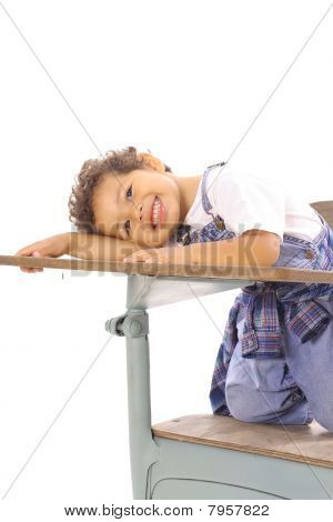 toddler sitting in a desk isolated vertical