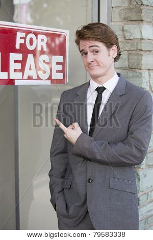 Man In Front Of A Store
