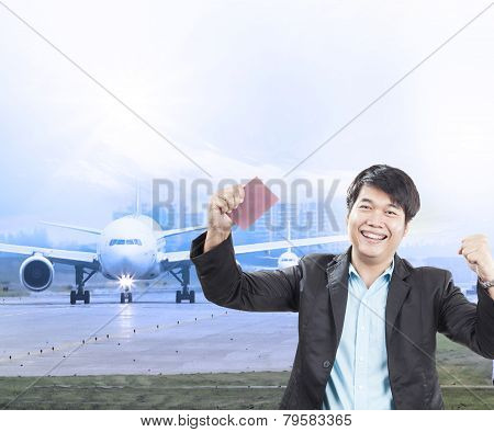 Young Business Man And Visa Passport In Hand Was Approve With Happy Face For Traveling By Plane To D